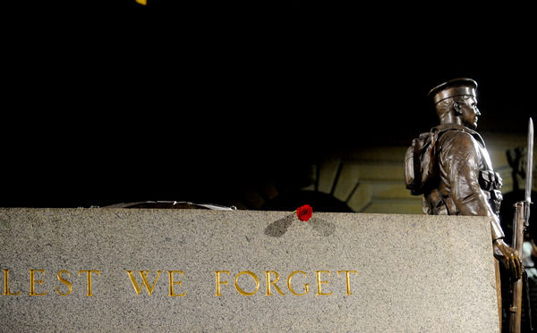 A single red rose sits on the cenotaph during the Anzac Day dawn service in Sydney