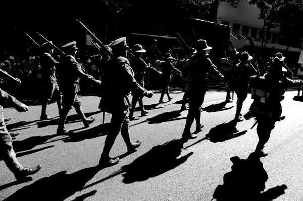 Men dressed up as World War One soldiers march during an Anzac Day parade in Brisbane