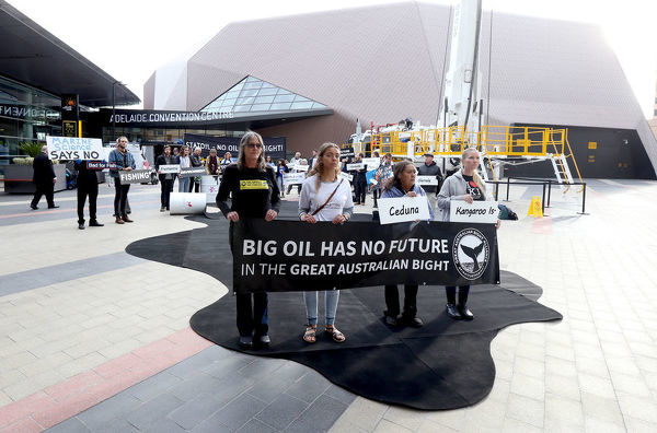 Protesters Jamilla Martin, Sue Haseldine, Susie Thistleton, Kyri Toumazos and Linda Irwin-oak stand on the oil spill carpet outside the Adelaide Convention Centre while Community groups protest at Australian Petroleum Production & Exploration