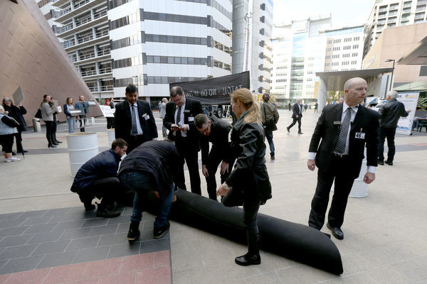 Convention centre security ask for the removal of the oil spill carpet outside the Adelaide Convention Centre