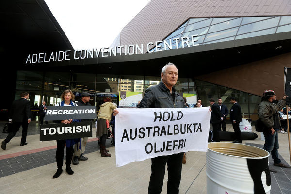 Community groups protest at Australian Petroleum Production & Exploration Association conference to say no to oil exploration in Great Australian Bight in Adelaide, Tuesday, May 15, 2018. (AAP Image/Kelly Barnes)