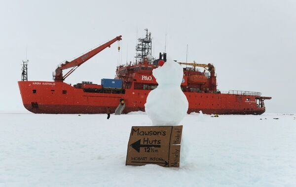 A sign and snow man placed by researchers and crew from the Australian Antarctic Divisions chartered icebreaker the Aurora Australis wedged in fast ice in Commonwealth Bay 10nm from Mawson's Hut in Antarctica