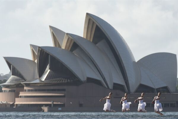 Jade Wood, Jess Fyfe, Eli Fryer and Sharni Spencer from the Australian Ballet perform scenes from Swan Lake against the backdrop of the Sydney Harbour Bridge and the Sydney Opera House in Sydney