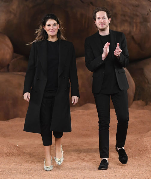 Camilla Freeman-Topper and Marc Freeman take the applause of the crowd after their Camilla and Marc fashion show during the Mercedes-Benz Fashion Week Australia in Sydney, Sunday, May 13, 2018. (AAP Image/David Moir), EDITORIAL USE ONLY