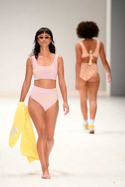 A model walks the runway wearing creations by Camp Cope Swimwear during the Swim show at Mercedes-Benz Fashion Week Australia in Sydney, Monday, May 14, 2018. (AAP Image/Dan Himbrechts), EDITORIAL USE ONLY