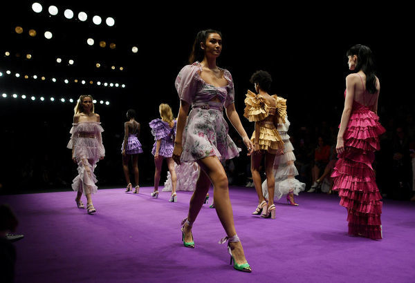 Models were creations by Alice McCall during the Mercedes-Benz Fashion Week Australia in Sydney, Monday, May 14, 2018. (AAP Image/David Moir), EDITORIAL USE ONLY