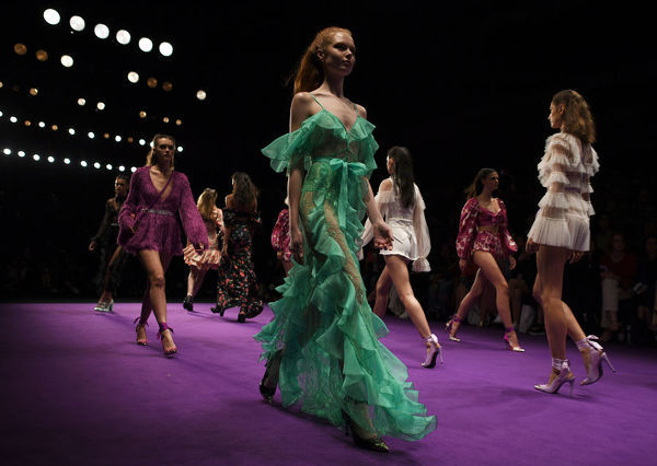 Models wear creations by Alice McCall during the Mercedes-Benz Fashion Week Australia in Sydney, Monday, May 14, 2018. (AAP Image/David Moir), EDITORIAL USE ONLY