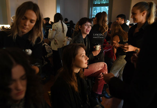 Models prepare backstage before the MacGraw fashion show during the Mercedes-Benz Fashion Week Australia in Sydney, Tuesday, May 15, 2018. (AAP Image/David Moir), EDITORIAL USE ONLY
