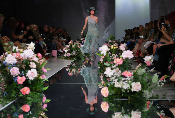 A model wears a creation by We Are Kindred during the Mercedes-Benz Fashion Week Australia in Sydney, Tuesday, May 15, 2018. (AAP Image/David Moir), EDITORIAL USE ONLY