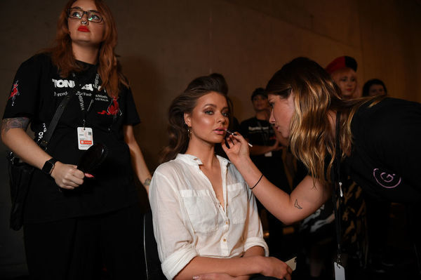 A model is seen preparing backstage ahead of the Jets show during Mercedes-Benz Fashion Week Australia in Sydney, Tuesday, May 15, 2018. (AAP Image/Dan Himbrechts), EDITORIAL USE ONLY