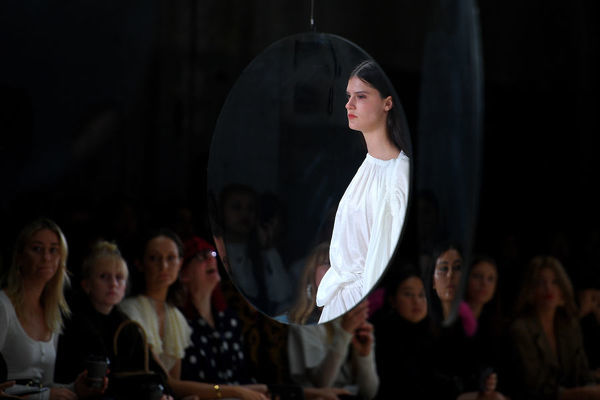 A model is reflected in a mirror as she walks the runway wearing creations by Acler during Mercedes-Benz Fashion Week Australia in Sydney, Wednesday, May 16, 2018. (AAP Image/Dan Himbrechts), EDITORIAL USE ONLY
