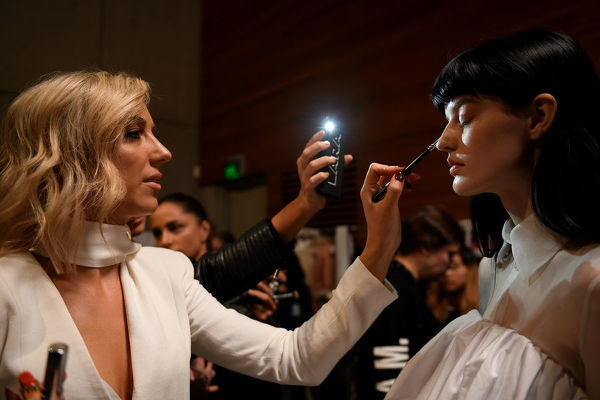 Models prepare backstage ahead of the Acler show during Mercedes-Benz Fashion Week Australia in Sydney, Wednesday, May 16, 2018. (AAP Image/Dan Himbrechts), EDITORIAL USE ONLY