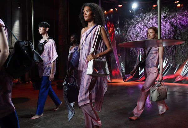 Models pose with bags from Deadly Ponies during the Mercedes-Benz Fashion Week Australia in Sydney, Wednesday, May 16, 2018. (AAP Image/David Moir), EDITORIAL USE ONLY