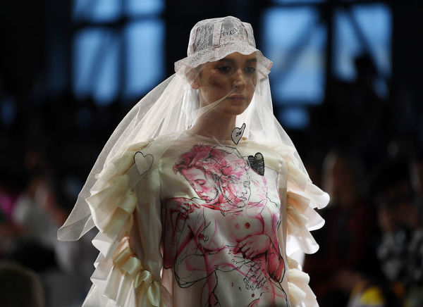 A model wears a creation by Zella May during the FDS: The Innovators show during the Mercedes-Benz Fashion Week Australia in Sydney, Wednesday, May 16, 2018. (AAP Image/David Moir), EDITORIAL USE ONLY