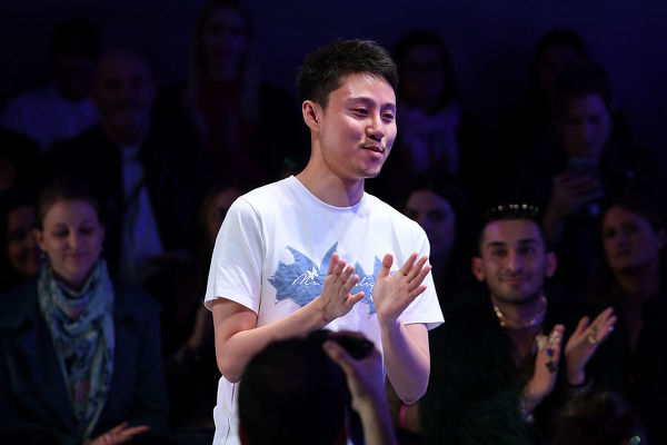 Leo & Lin designer Leo Lin gestures following his show during Mercedes-Benz Fashion Week Australia in Sydney, Thursday, May 17, 2018. (AAP Image/Dan Himbrechts), EDITORIAL USE ONLY