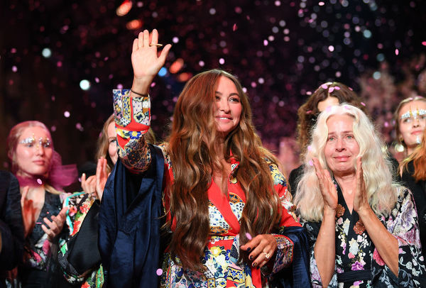 Designer Camilla Franks reacts to applause at the end of her Camilla fashion show during the Mercedes-Benz Fashion Week Australia in Sydney, Thursday, May 17, 2018. (AAP Image/David Moir), EDITORIAL USE ONLY