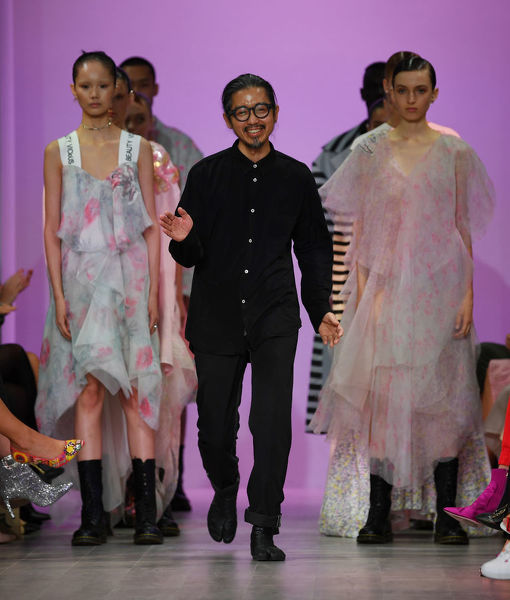 Fashio designer Akira Isogawa walks on stage after his Akira fashion show during the Mercedes-Benz Fashion Week Australia in Sydney, Thursday, May 17, 2018. (AAP Image/David Moir), EDITORIAL USE ONLY