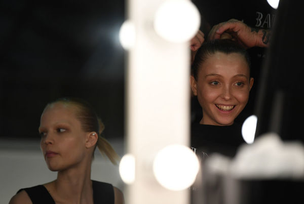 Models get ready backstage before the Akira fashion show during the Mercedes-Benz Fashion Week Australia in Sydney, Thursday, May 17, 2018. (AAP Image/David Moir), EDITORIAL USE ONLY