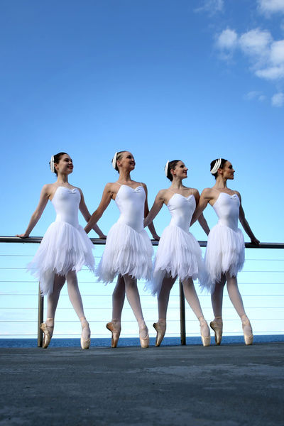 (L-R) Corey Herbet, Kismet Bourke, Emma McFarlane and Brooke Lockett, members of the Australian Ballet, pose for photographs at Icebergs pool, Bondi Beach, Sydney