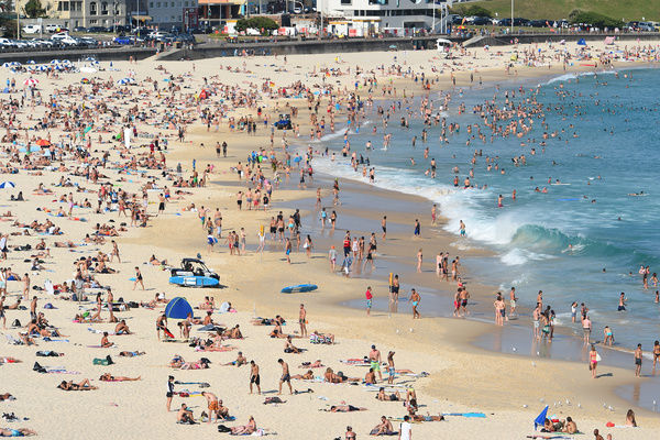 People are seen at Bondi Beach as temperatures reach 41 degrees, in Sydney, Friday, Nov