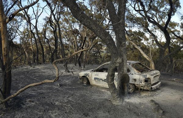A burnt out car in Kersbrook as fires continue to burn through the Adelaide Hills