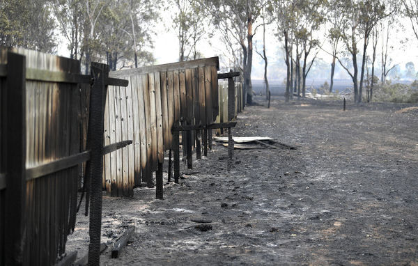 A fence damaged by bushfires is seen in Laidley, southeast Queensland, Wednesday, October 9, 2019. (AAP Image/Scott Davis) NO ARCHIVING
