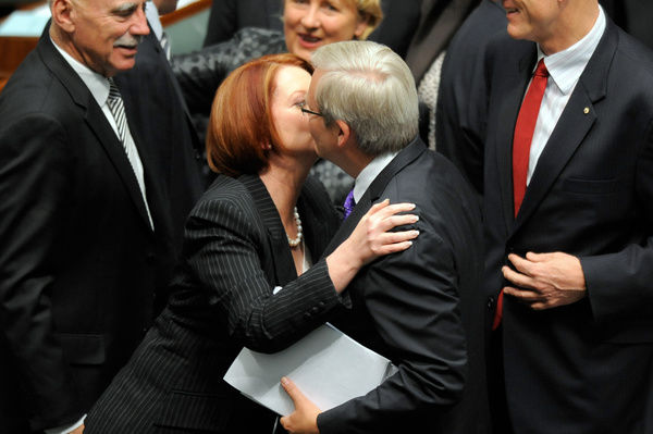 Prime Minister Julia Gillard hugs and kisses foreign minister Kevin Rudd after the carbon tax legislation was passed in the House of Representatives in Canberra