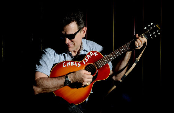 American rock musician Chris Isaak poses for photographs at Club 23 in Melbourne