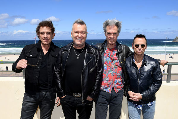 (L-R) Members of Australian rock band Cold Chisel Ian Moss, Jimmy Barnes, Don Walker and Phil Small pose for a photograph following a press conference at Bondi Pavilion in Sydney, Wednesday, October 9, 2019