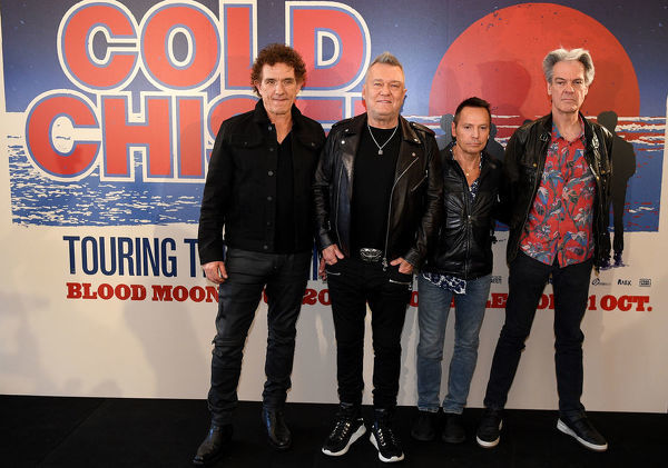 (L-R) Members of Australian rock band Cold Chisel Ian Moss, Jimmy Barnes, Phil Small and Don Walker pose for a photograph following a press conference at Bondi Pavilion in Sydney, Wednesday, October 9, 2019