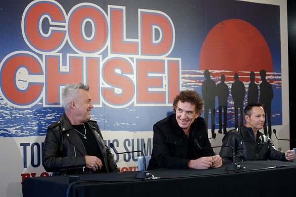 Jimmy Barnes, Ian Moss and Phil Small of Australian rock band Cold Chisel attend a press conference at Bondi Pavilion in Sydney, Wednesday, October 9, 2019. The band has announced they will embark on a summer tour of Australia and New Zealand playing at outdoor venues