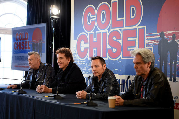(L-R) Members of Australian rock band Cold Chisel Jimmy Barnes, Ian Moss, Phil Small and Don Walker attend a press conference at Bondi Pavilion in Sydney, Wednesday, October 9, 2019. The band has announced they will embark on a summer tour of Australia