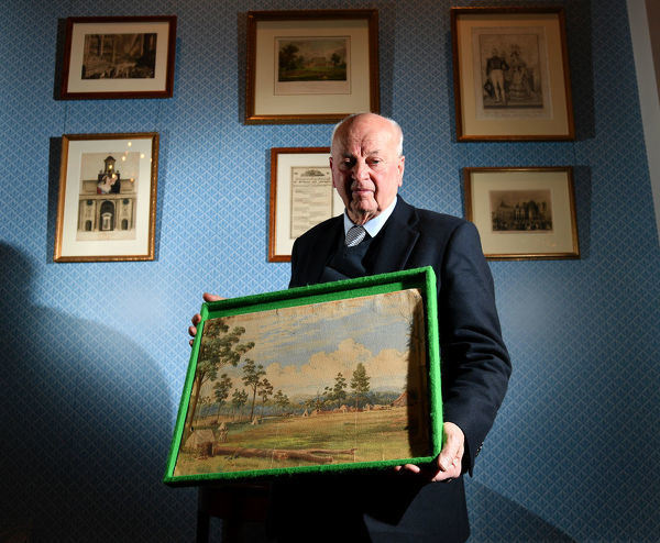 Auctioneer Jim Elder is seen with the 180 year-old painting by Colonel William Light at the Adelaide Town Hall in Adelaide, Monday, September 9, 2019. A 180-year-old painting by Colonel William Light, the man who picked the location for Adelaide