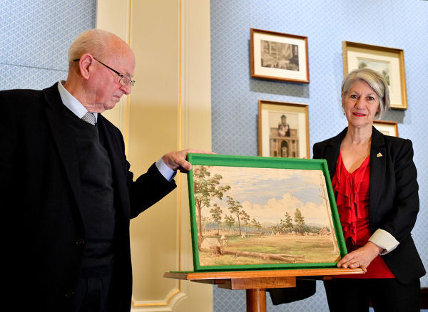 Auctioneer Jim Elder and Mayor of Adelaide Sandy Verschoor are seen with the 180 year-old painting by Colonel William Light at the Adelaide Town Hall in Adelaide, Monday, September 9, 2019. A 180-year-old painting by Colonel William Light