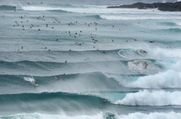 Surfers enjoy the swell courtesy of Tropical Cyclone Marcia at Snapper Rocks on the Gold Coast