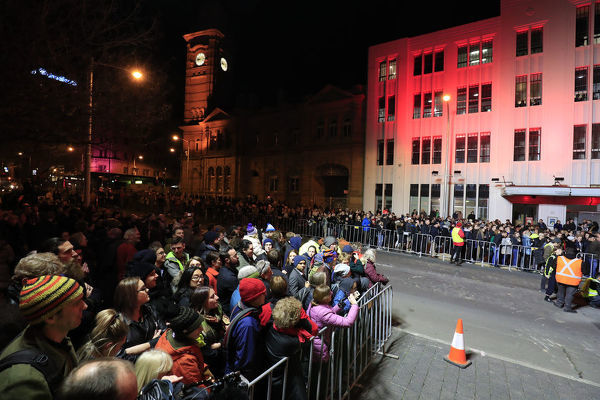 Crowds witness Hobart's Macquarie St being excavated to encase artist Mike Parr during Tasmania's Dark Mofo festival in Hobart, Thursday, June 14, 2018. (AAP Image/Rob Blakers), EDITORIAL USE ONLY