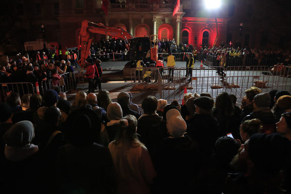 Crowds witness artist Mike Parr being encased beneath Hobart's Macquarie St during Tasmania's Dark Mofo festival in Hobart, Thursday, June 14, 2018. (AAP Image/Rob Blakers), EDITORIAL USE ONLY