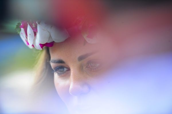 Catherine, Duchess of Cambridge wears a floral crown after a reception for women of the Solomon Islands in Honiara