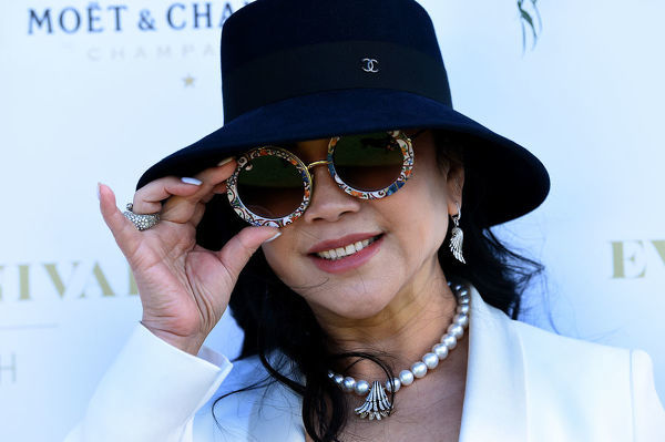 Property agent Monika Tu poses for a photograph during the inaugural Everest Carnival Fashion Lunch at Royal Randwick Racecourse in Sydney, Thursday, October 10, 2019. (AAP Image/Bianca De Marchi) NO ARCHIVING