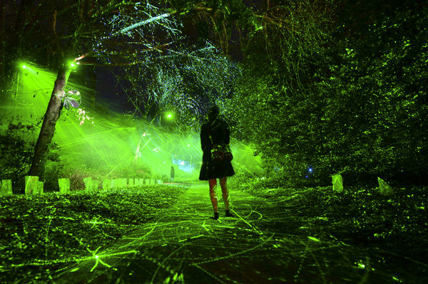 A member of the media is seen during a preview of the illumination activation of NightFest at Floriade in Canberra