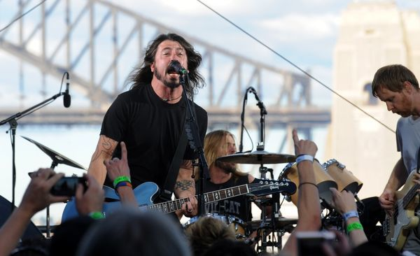 Dave Grohl (left), Taylor Hawkins (back) and Nate Mendel of the Foo Fighters perform on Goat Island in Sydney Harbour for their Wasting Light on the Harbour concert in Sydney