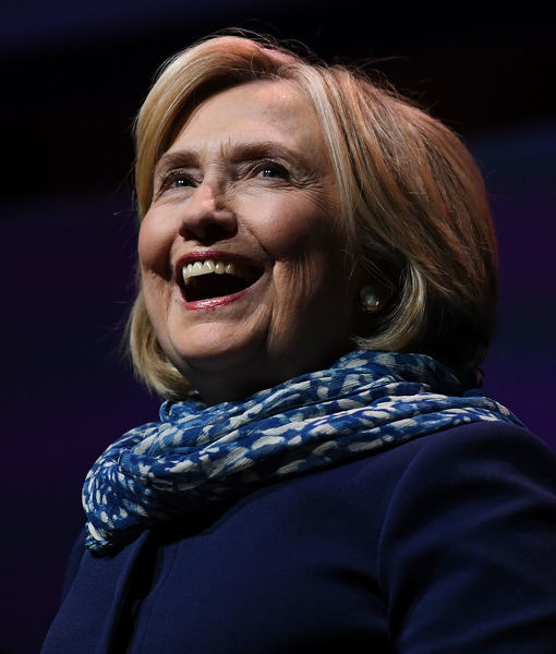Former US secretary of state Hillary Clinton smiles as she walks on stage before speaking at a Women World Changers Series event at the ICC Sydney Theatre in Sydney, Thursday, May 11, 2018. (AAP Image/David Moir)