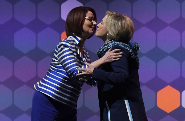 Former US secretary of state Hillary Clinton (right) embraces former Australian prime minister Julia Gillard during a Women World Changers Series event at the ICC Sydney Theatre in Sydney, Thursday, May 11, 2018. (AAP Image/David Moir)