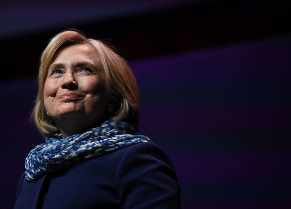 Former US secretary of state Hillary Clinton reacts as she walks on stage during a Women World Changers Series event at the ICC Sydney Theatre in Sydney, Thursday, May 11, 2018. (AAP Image/David Moir)