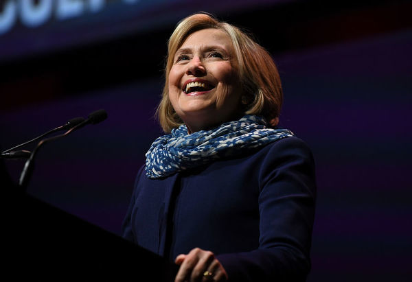 Former US secretary of state Hillary Clinton smiles while speaking on stage during a Women World Changers Series event at the ICC Sydney Theatre in Sydney, Thursday, May 11, 2018. (AAP Image/David Moir)