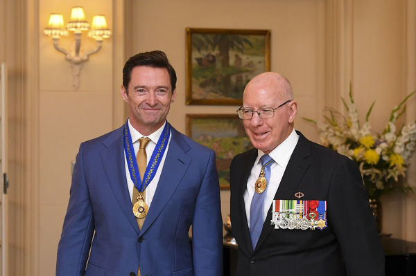 Australian Governor-General David Hurley (right) poses for photographs with Australian Actor Hugh Jackman after he was awarded the Order of Australia for eminent service to the performing arts as an acclaimed actor and performer