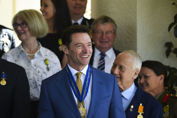 Australian Actor Hugh Jackman poses for photographs with other recipients after he was appointed a Companion in the General Division for eminent service to the performing arts as an acclaimed actor and performer, and to the global community