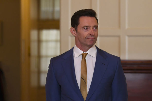 Australian Actor Hugh Jackman waits to be awarded the Order of Australia for eminent service to the performing arts as an acclaimed actor and performer, and to the global community, particularly as an advocate for poverty eradication