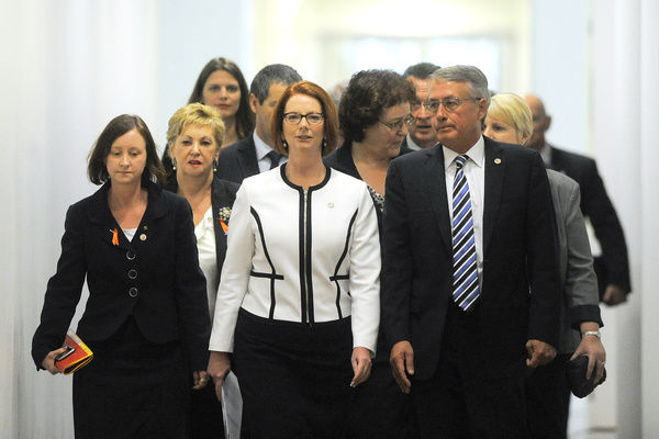 Prime Minister Julia Gillard and members of the caucus arrive for a meeting in Canberra