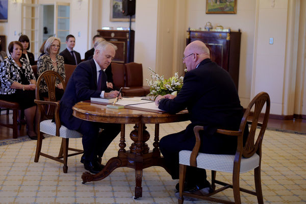 Malcolm Turnbull (left) is sworn in by Australia's Governor-General Sir Peter Cosgrove as Australia's 29th Prime Minister at Government House in Canberra